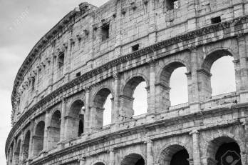 Exterior of the Colosseum or Coliseum, also known as the Flavian Amphitheatre. Black and white photo