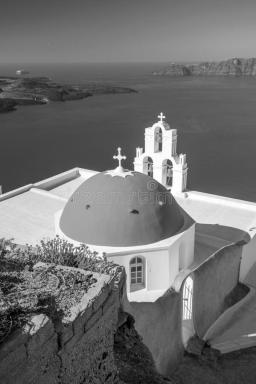 three-bells-fira-santorini-greece-blue-sky-black-white-182697400