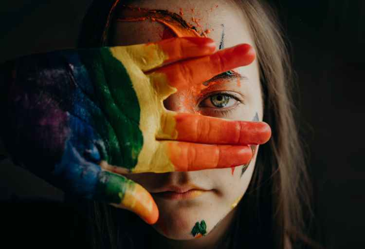 a girl with a painted hand and face