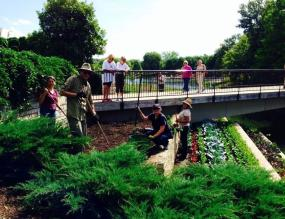 PHOTO: Staff and volunteers plant the Fruit & Vegetable Garden terraces with fall season crops.
