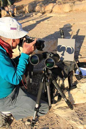 Rangers in Grand Canyon National Park use eclipse filters on a pair of binoculars during an annular eclipse viewing in 2012.