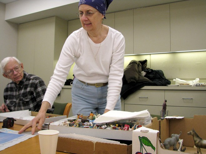 PHOTO: Volunteer Becky Maganuco with a box of miniatures.