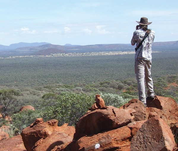 PHOTO: CLM intern Dominic DiPaolo-Kalb looks out over a Western United States vista of red rock.
