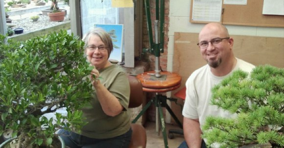 PHOTO: Volunteer Eileen Michal working on Bonsai with Chris Baker.