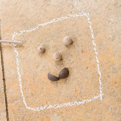 PHOTO: Face drawing made from seeds and chalk.