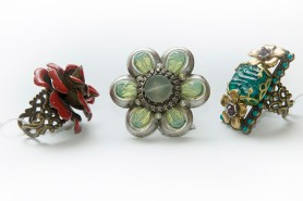 PHOTO: A collection of 3 rings in the shape of various flowers.