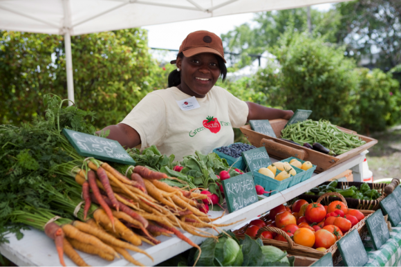 PHOTO: Green Youth Farm crew member Evon at the North Lawndale community farm stand.