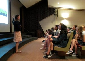PHOTO: Ksiazek presents her work to a girls' middle school.