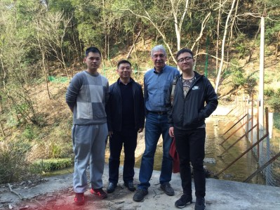 Collaborators tour a study site in China.