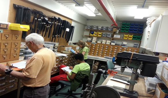 PHOTO: Volunteers Doris and Leon and intern Tremaine processing label requests.
