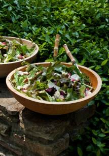 Simple ingredients served in abundance, such as fresh salad from the farmers' market, bring grace and style to a summer party.