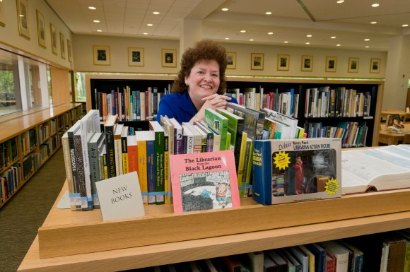 PHOTO: Stacy Stoldt organizing bookshelves.
