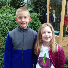 Kids visiting corpse flower bloom, wearing a corpse flower t-shirt.