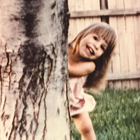 Andrea in her backyard in Nebraska, age 2