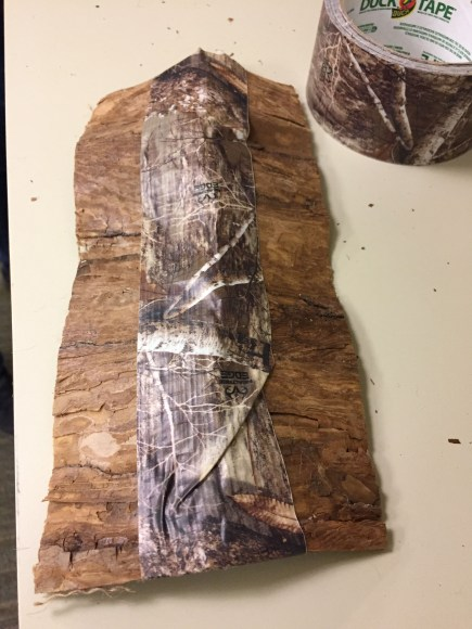 Make a roof with bark ribbon and duct tape.
