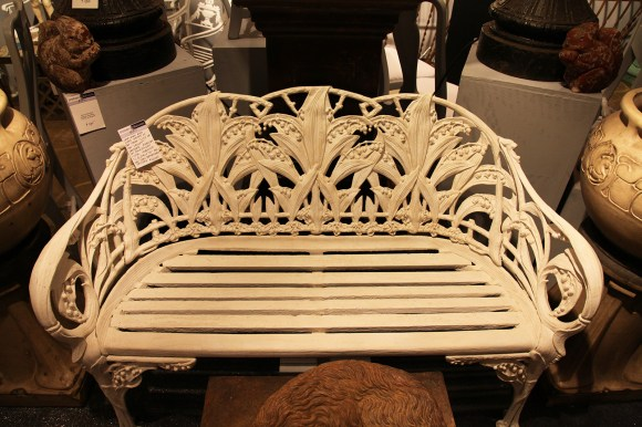 PHOTO: Whitewashed antique wrought iron bench.