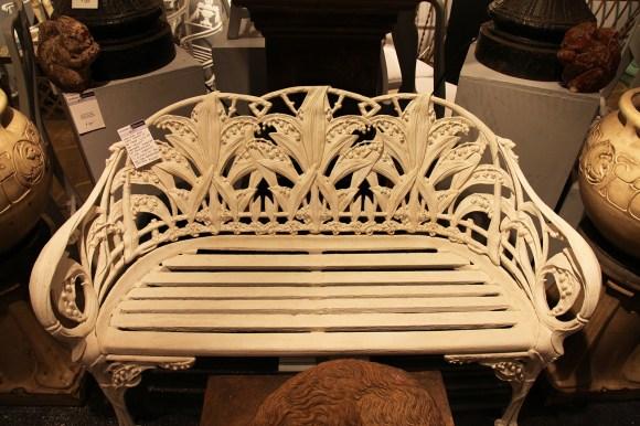 PHOTO: Whitewashed antique wrought iron bench.