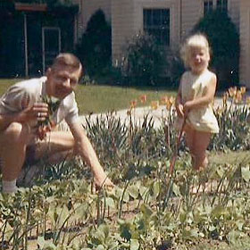 Lisa, age 3, with her dad in Iowa