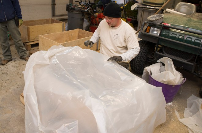 PHOTO: Adding the second sheet of plastic on top of the poured bottom.