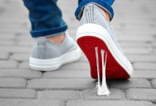 Person walking as gum gets stuck to the bottom of their shoe. What keeps you stuck?