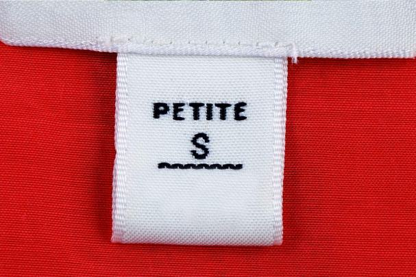 White Petite S tag on red clothing: How to dress to flatter a petiti figure