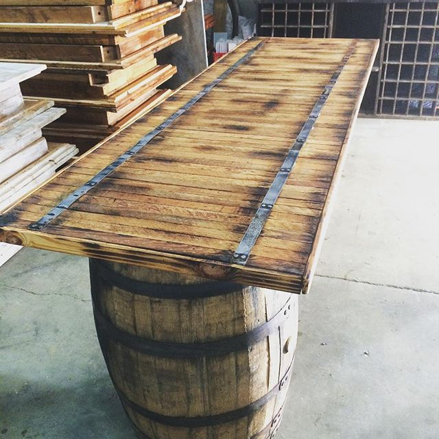 Cheers to our new wine barrel bar top handmade from for How to build a wine bar