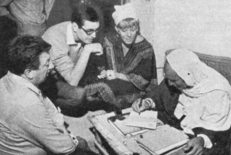 """In an Arabian market place, Lew Luton, above left, gets all geared up in Tunisian clothes. Below, Lanning and Tony Morton (left) and Sue Nicholls (right) meet a Tunisian letter-writer, who was ready to pen this """"Lanning at Large"""" for approximately £1 5s. 0d.!"""