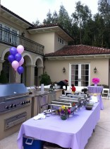 Pink and purple balloons unify all the party spaces