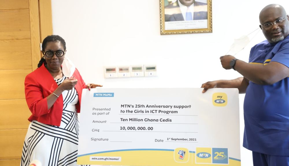 Ursula Owusu receiving a cheque from an officer of MTN Ghana