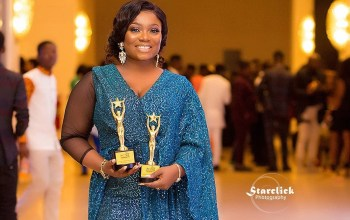 Stacy Amoateng holding her award plaques at the 2020 RTP awards