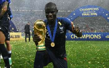 N'Golo Kante holding the world cu trophy in Russia 2018