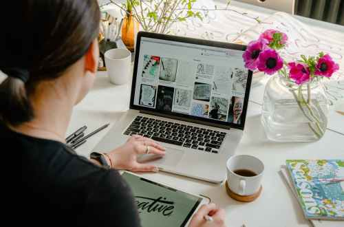 photo of person using laptop for graphic designs