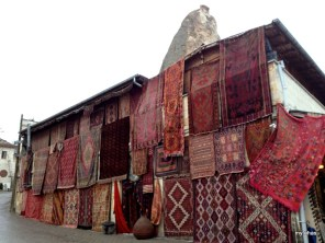 A display of rugs at a rug shop in Göreme
