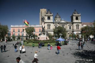 Plaza Murillo with the Presidential Palace at left and Cathedral of La Paz at right.