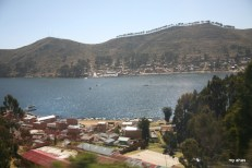 View from our moving bus showing boats crossing the Strait of Tiquina.