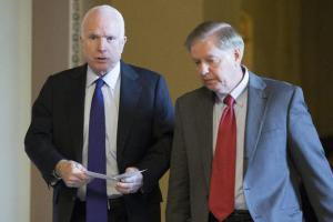 "Sen. John McCain, left, and Sen. Lindsey Graham, seen here on Nov. 16, 2016, said the Obama adminstration's sanctions on Russia ""are a small price for Russia to pay for its brazen attack on American democracy. We intend to lead the effort in the new Congress to impose stronger sanctions on Russia."" (Michael Reynolds / EPA)"