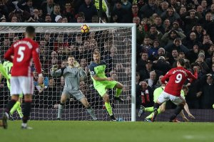 Manchester United's Zlatan Ibrahimovic, right, headed in a goal during a match against Liverpool in Manchester on Sunday. Credit Nigel Roddis/European Pressphoto Agency