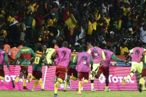 Cameroon have reached the African Nations Cup semifinals after a dramatic shootout win over Senegal.