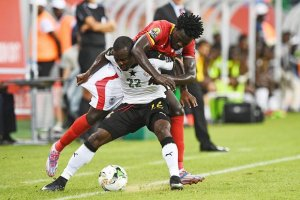 Ghana's Frank Acheampong shields the ball from Uganda's Moses Oloya. Photograph: Justin Tallis/AFP/Getty Images