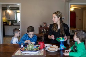 Elizabeth Hernandez with her sons, from left, Gianluca, 6, Kharloz, 8, and Maximus, 2, at their home in West Frankfort, Ill. Ms. Hernandez's husband, Juan Carlos Hernandez Pacheco, was taken into custody earlier this month by Immigration and Customs Enforcement.  Credit Whitney Curtis for The New York Times