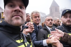 Geert Wilders, center, a far-right icon and one-man political party of the Netherlands, greeting supporters during a campaign stop in Spijkenisse this month. Credit Sergey Ponomarev for The New York Times