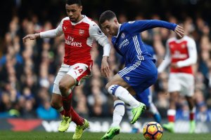 Eden Hazard, right, dribbling past Arsenal's Francis Coquelin during Chelsea's 3-1 victory at home Saturday. Credit Adrian Dennis/Agence France-Presse — Getty Images