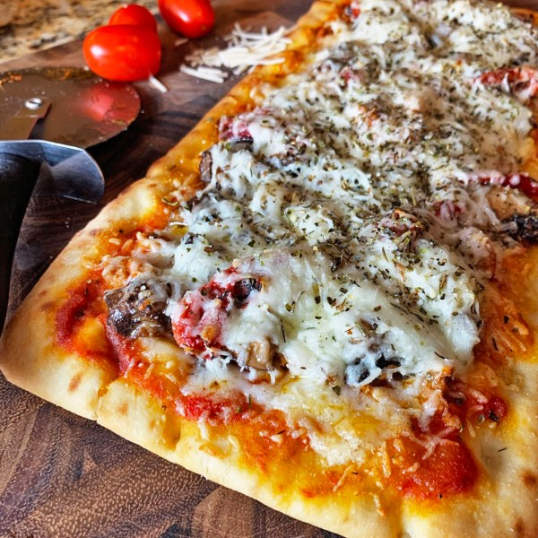 Flatbread pizza using Aldi flatbread, topped with cheese and oregano.