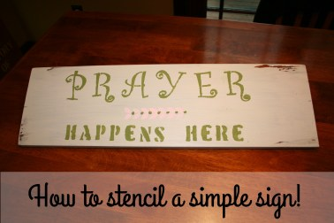 Wood sign stenciled with Prayer Happens Here