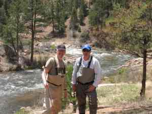 Malcolm David Logan and Tim Lincoln fly fishing in Colorado.