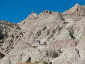 Hikers on Saddle Pass Trail in Badlands National Park
