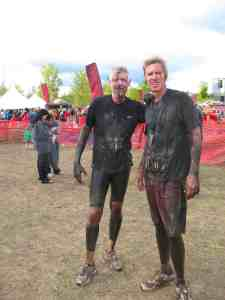 Malcolm Logan and Curt Logan covered with mud at the Warrior Dash