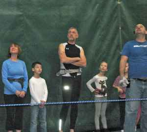 Joan Anundsen, Malcolm Logan and others wait for their turn at New York Trapeze School in Chicago
