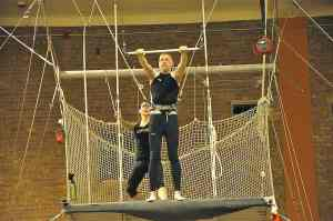 Malcolm Logan preparing for his first jump at New York Trapeze School in Chicago