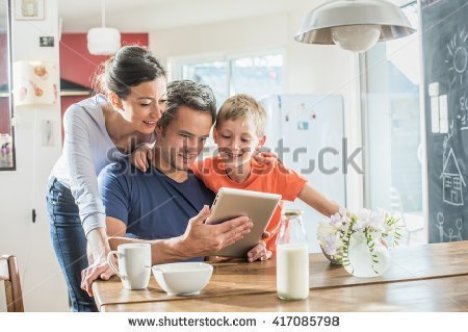 stock-photo-a-modern-family-using-a-digital-tablet-while-having-breakfast-in-the-kitchen-mom-dad-and-their-417085798